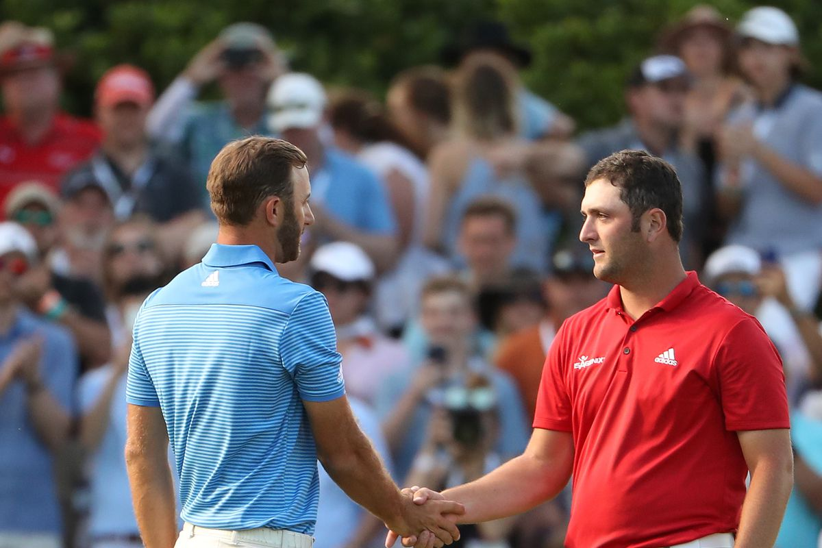 Dustin Johnson shakes hands with Jon Rahm of Spain after winning the World Golf Championships-Dell Technologies Match Play at the Austin Country Club on March 26, 2017 in Austin, Texas.