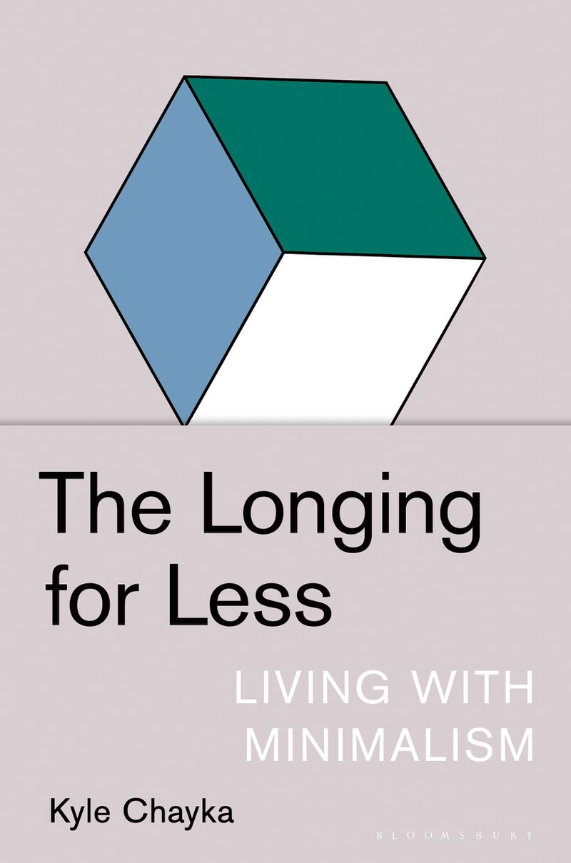 """A book cover for """"The Longing for Less: Living with Minimalism"""" features a gray background with a hexagon composed of three green, white, and blue diamonds"""