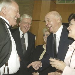Former BYU head football coach LaVell Edwards laughs with Elder Russell M. Ballard and Dallin H. Oaks of the Quorum of the Twelve Apostles of The Church of Jesus Christ of Latter-day Saints during a tribute April 11, 2001.