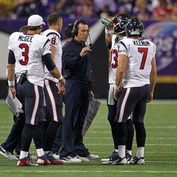 Aug 9, 2013; Minneapolis, MN, USA; Houston Texans head coach Gary Kubiak talks to the quarterbacks during a timeout in the second quarter against the Minnesota Vikings at the Metrodome.