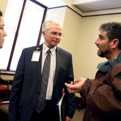 Andy Borrego, long-term recovery program manager at First Step House, left, Joe Miner, executive director of the Utah Health Department, center, and Dan Davidson talk after a press conference at the Capitol in Salt Lake City on Friday, Jan. 29, 2016, where legislators presented a group of bills targeted at the opioid overdose crisis that is sweeping the state. Davidson is a recovering heroin addict, now working as a counselor for others.