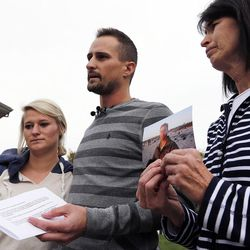 Family members speak about Russell Jacobs in East Millcreek, Friday, Oct. 30, 2015. They are Kallie Stolk, left, niece, Brian Stolk, nephew, and Lyne Miller, a cousin to Jacobs' wife. She holds a photo of Jacobs, who died after being shot Oct. 29, 2015.
