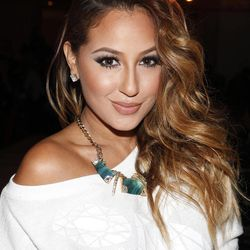 Adrienne Bailon attends the Abbey Dawn By Avril Lavigne Spring 2013 Runway Show on Monday, Sept. 10, 2012 in New York.