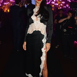 Adriana Lima in an Alessandra Rich dress, Chopard jewels, and a Roger Vivier clutch at the Chopard Wild party.