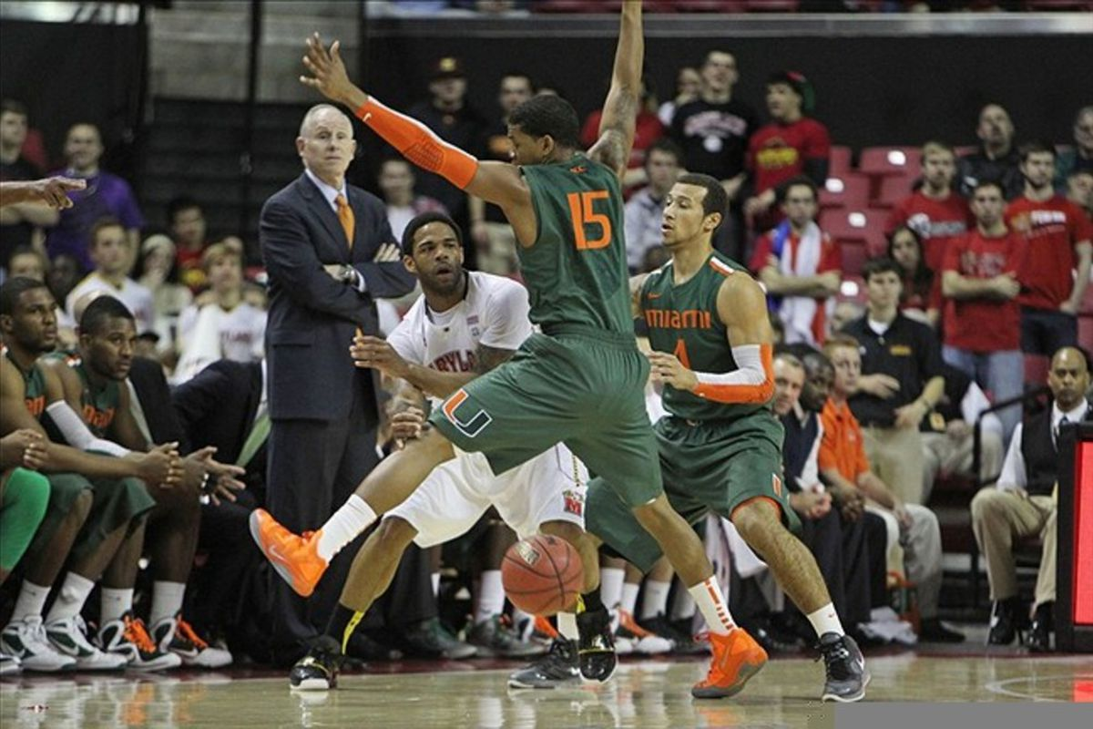 February 21, 2012; College Park, MD, USA; Miami Hurricanes guard Rion Brown (15) and Trey McKinney Jones (4) defend against Maryland Terrapins guard Sean Mosley (14) at Comcast Center. Mandatory Credit: Mitch Stringer-US PRESSWIRE