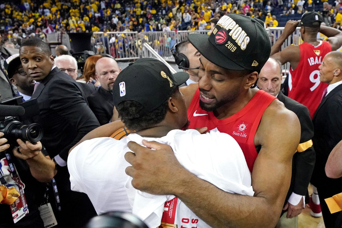 Toronto Raptors forward Kawhi Leonard and guard Kyle Lowry celebrate after beating the Golden State Warriors in game six of the 2019 NBA Finals to win the NBA Championship at Oracle Arena.
