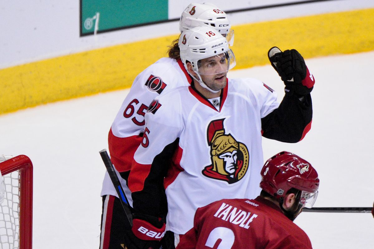 Clarke MacArthur demonstrates the difficulty in playing Rock-Paper-Scissors with hockey gloves on.