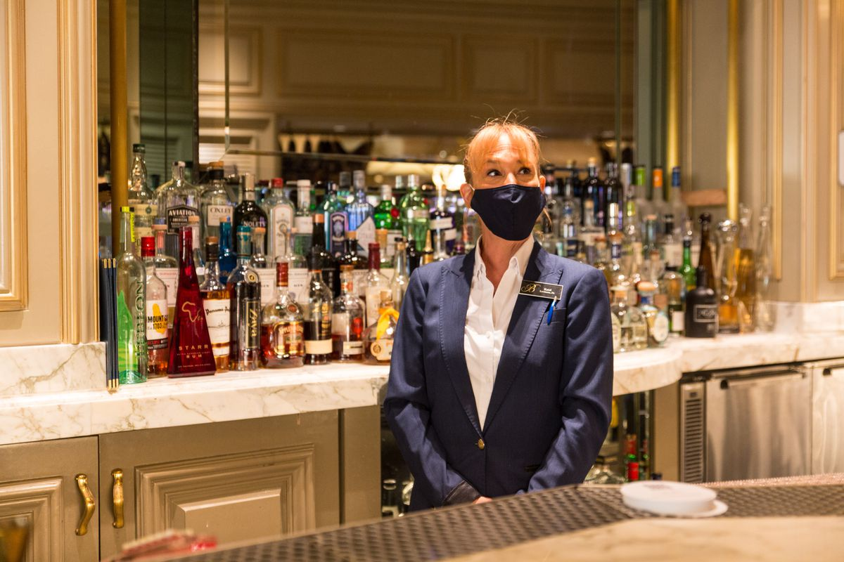 A bartender stands behind the bar at Petrossian at the Bellagio