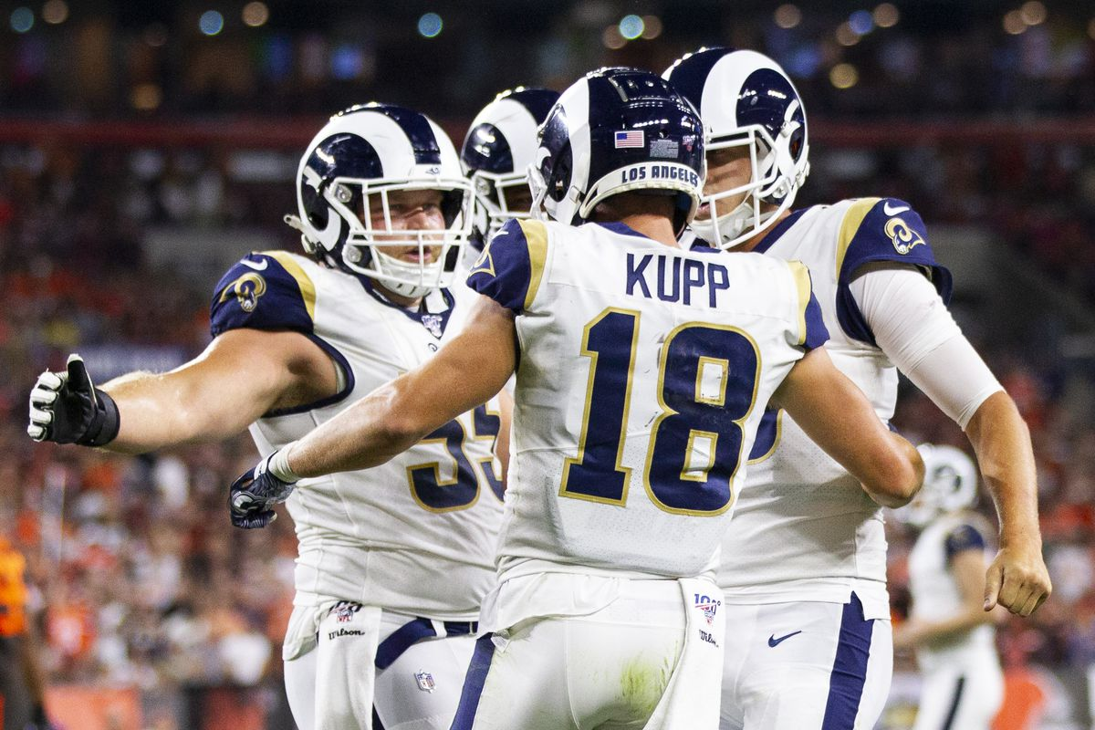 Los Angeles Rams wide receiver Cooper Kupp celebrates his touchdown with center Brian Allen and quarterback Jared Goff during the third quarter at FirstEnergy Stadium.