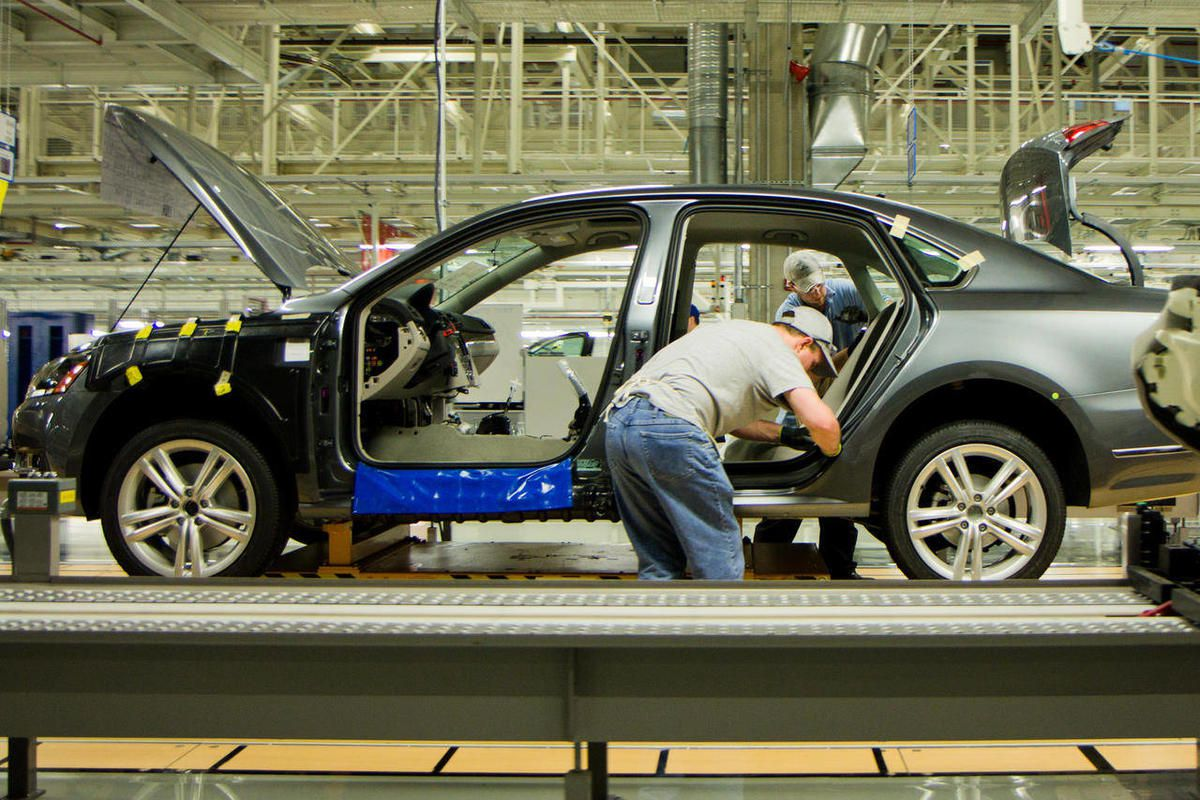 FILE - In this March 22, 2012, file photo, workers assemble a Passat sedan at Volkswagen AG's plant in Chattanooga, Tenn. The German automaker is conducting a national ad campaign to attract skilled workers to fill 1,000 new jobs at the plant this year.
