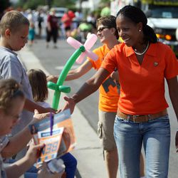 Mia Love, front, and Becky Pirente, campaign political director, greet people while walking in the Harvest Days Parade in Midvale on Saturday, Aug. 11, 2012.