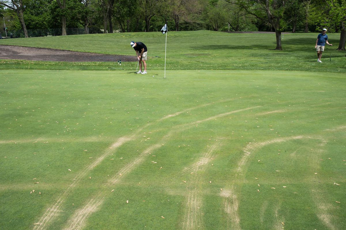 A golfer plays at Jackson Park Golf Course on Friday, a day after a man drove onto the South Side course.