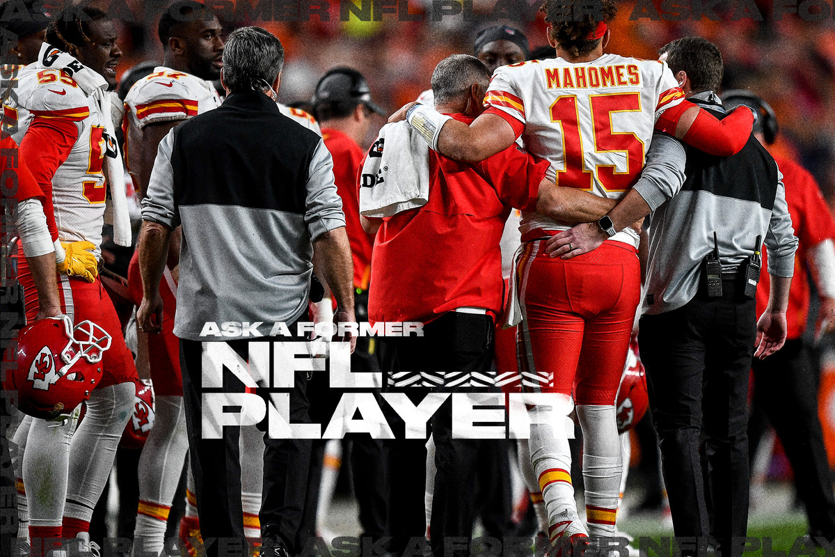 Chiefs QB Patrick Mahomes is standing up and helped off the field by two members of the training staff