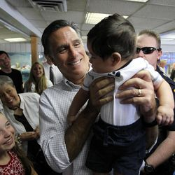 Mitt Romney greets people in the crowd after he meets with businessmen and politicians at Hires Big H Drive-in in Salt Lake City on Friday, June 24, 2011.