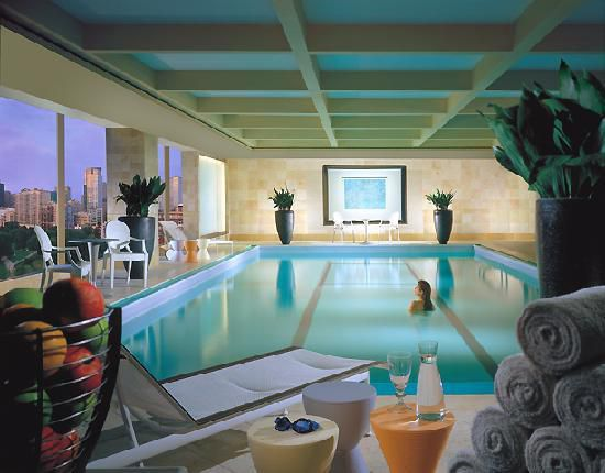 An indoor pool with various amenities flanking the pool.