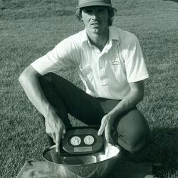 Utah State golfer Jay Don Blake poses with the hardware after winning the 1980 NCAA Championship.