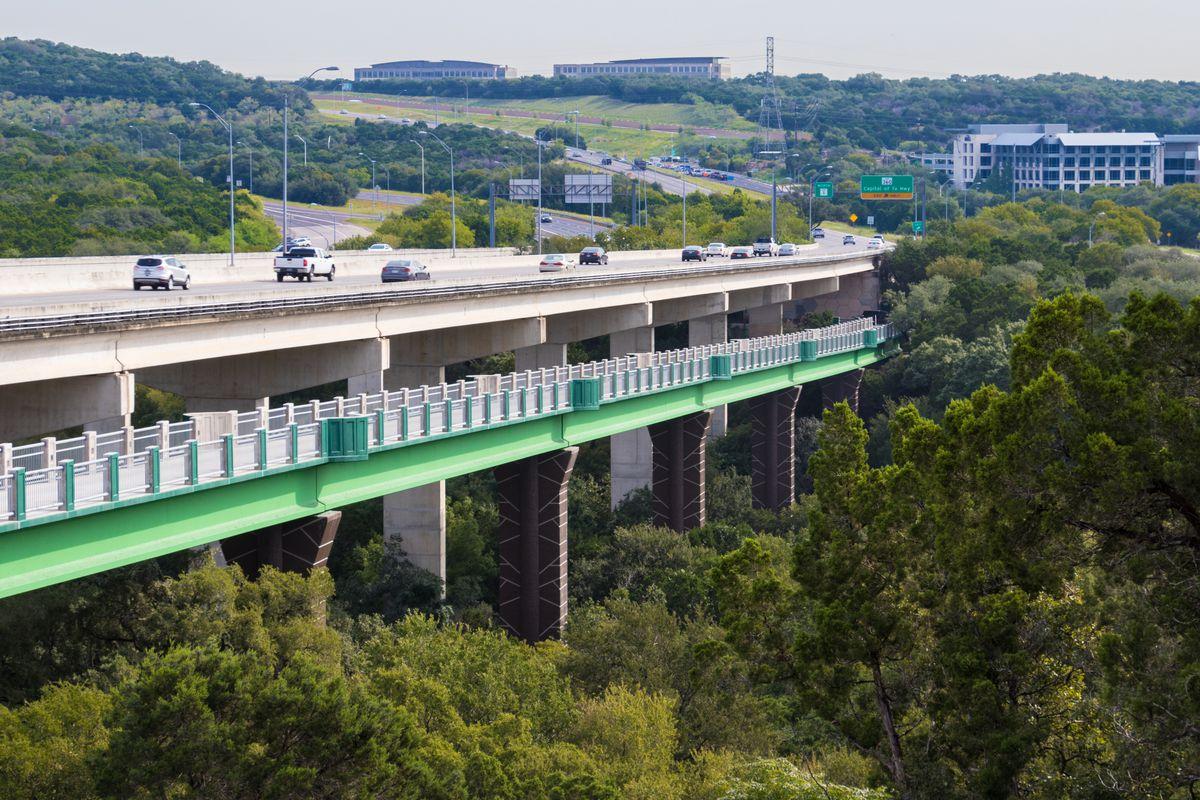 Bicycle commuter bridge under a highway
