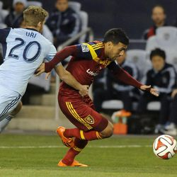 Real Salt Lake's Javier Morales fights for the ball from Sporting KC's Oriol Rosell during a game at Sporting Park in Kansas City, Kan., on Saturday, April 5, 2014.