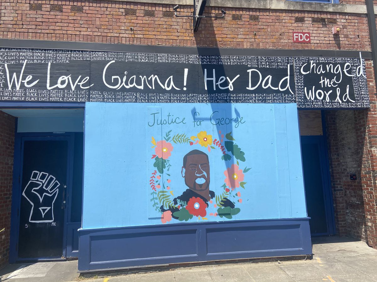 A tribute to George Floyd and message to his daughter Gianna, painted by Centro's staff. Original artwork by Afghanistan artist Shirien Damra.