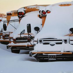 Snow drifts on and around school busses parked at First Student, Inc. in Lawrence, Kan., Wednesday, Feb. 2, 2011. Schools in USD 497 are closed for a second day because of the winter storm that moved through the area.