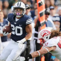 Brigham Young Cougars' Kj Hall (20) runs against the Southern Utah Thunderbirds   in Provo on Saturday, Nov. 12, 2016.