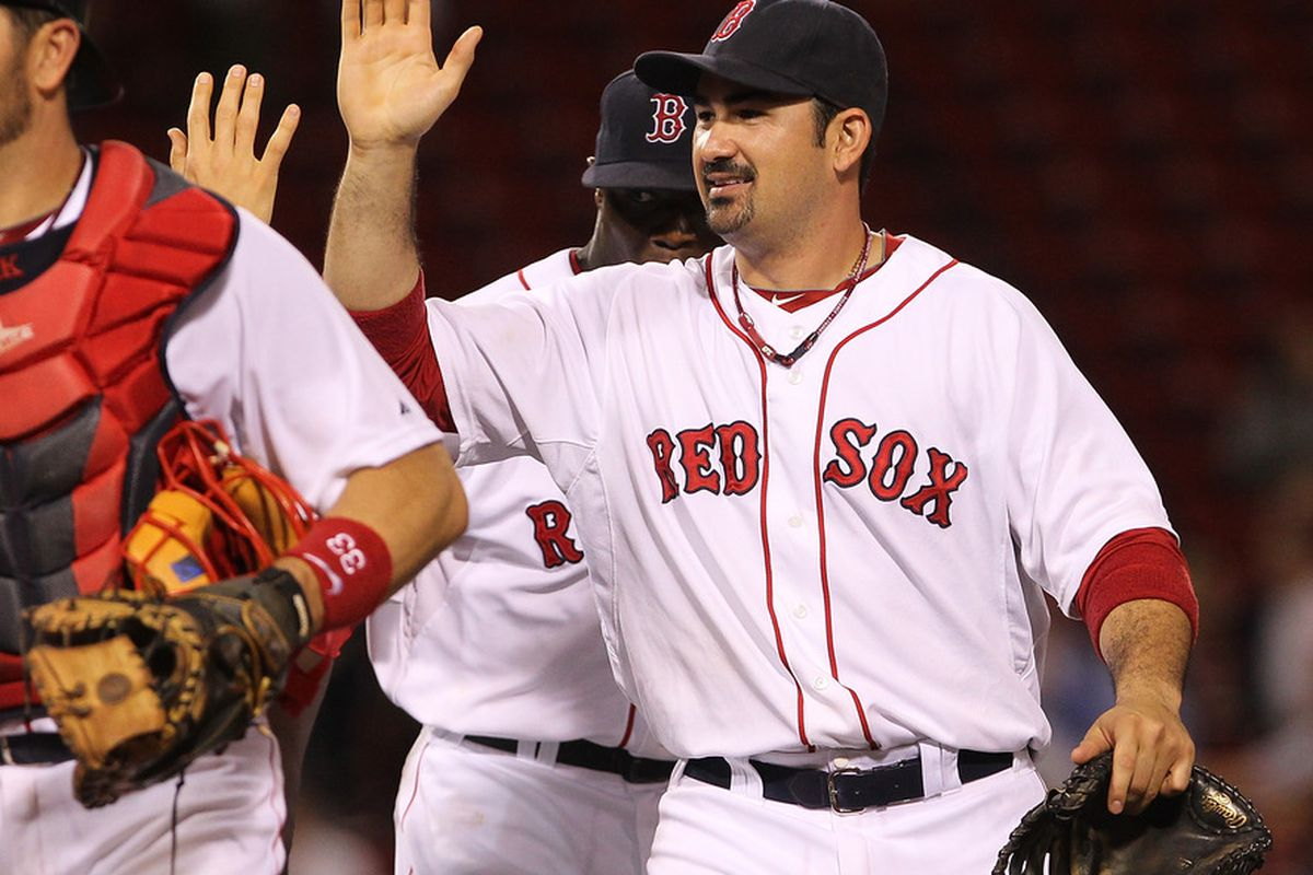 BOSTON, MA  - JUNE 20:  Adrian Gonzalez #28 of the Boston Red Sox celebrates a 14-5 win over the San Diego Padres at Fenway Park on June 20, 2011 in Boston, Massachusetts.  (Photo by Jim Rogash/Getty Images)