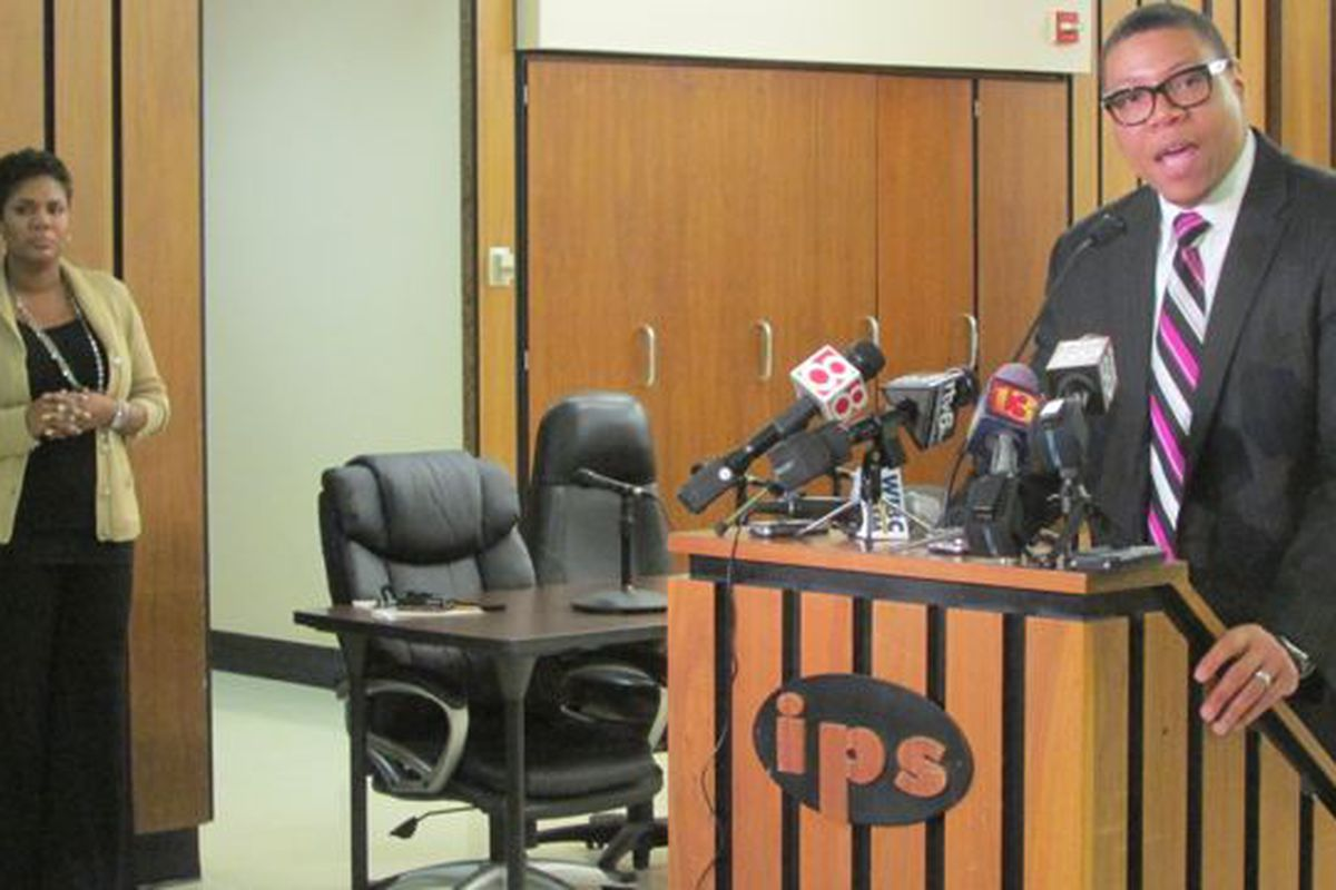 Le Boler,organizational strategist at IPS, looked on as Superintendent Lewis Ferebee spoke to the press last March about the district's financial situation.