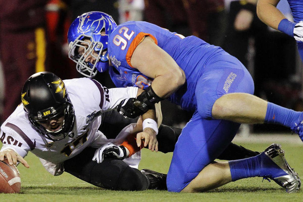 FILE - In this Dec. 22, 2011, file photo, Arizona State quarterback Brock Osweiler (17) reaches for the ball after a bad snap as Boise State defensive end Shea McClellin (92) defends in the first half of the Maaco Bowl NCAA college football game in Las Ve