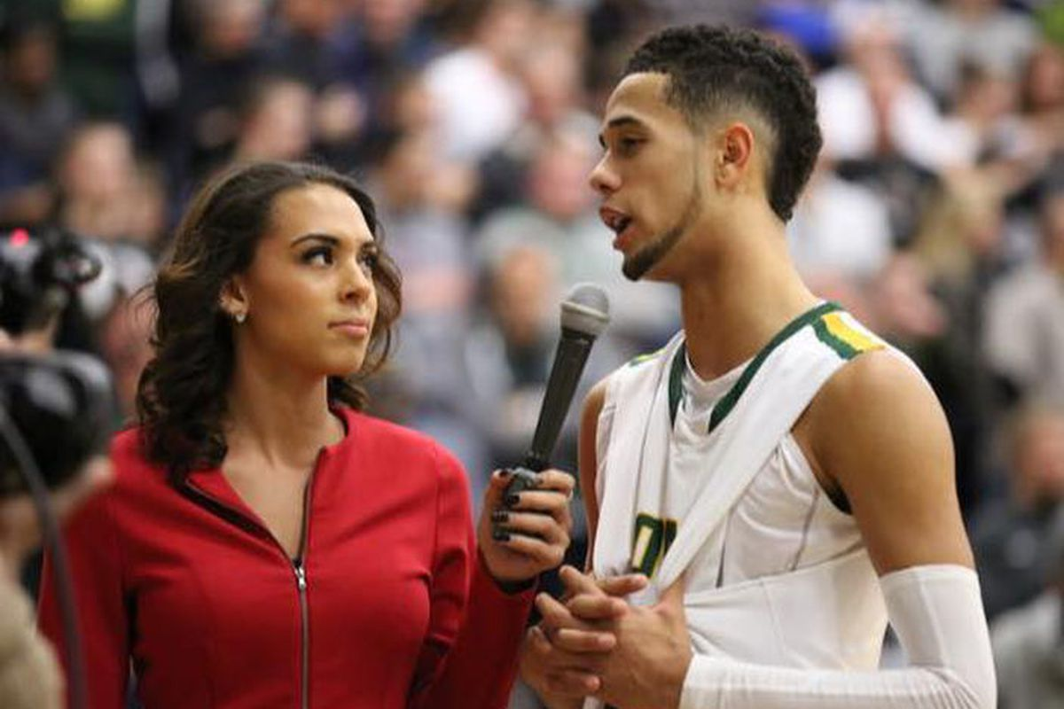 Ashley interviewing a Anthony Mathis after a game