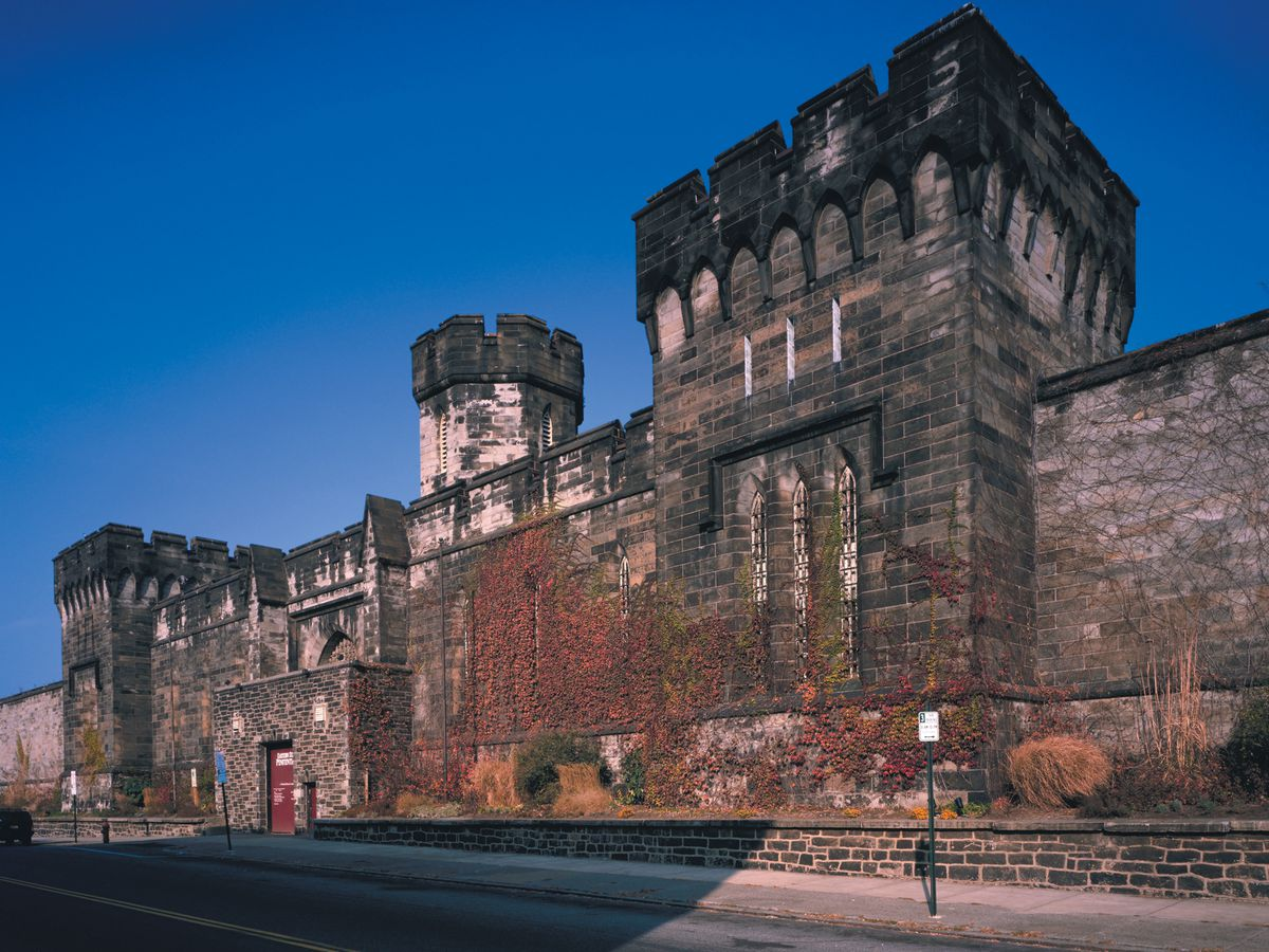 The exterior of the Eastern State Penitentiary. The facade is stone and there are multiple towers.