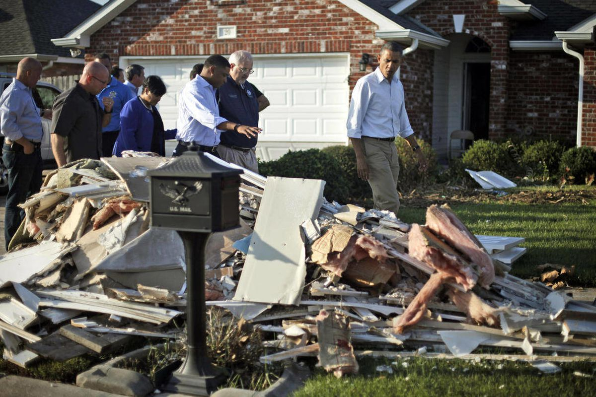 President Barack Obama walks past debris on the sidewalks as he tours the Bridgewood neighborhood in LaPlace, La., in the Saint John the Baptist Parish, with local officials to survey the ongoing response and recovery efforts to Hurricane Isaac, Monday, S