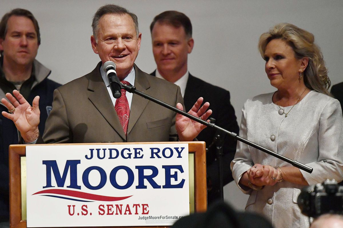 U.S. Senate candidate Roy Moore speaks as his wife Kayla Moore, right, listens at the RSA activity center, Tuesday, Dec. 12, 2017, in Montgomery, Ala. Moore did not concede defeat to his Democratic opponent Doug Jones.(AP Photo/Mike Stewart)