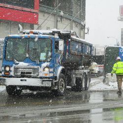 Dumpster pulling out at Clark & Addison -