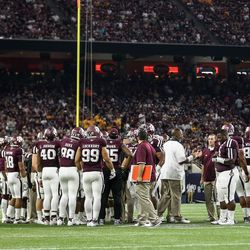 The Aggies huddle up