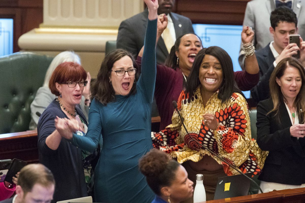 State Rep. Kelly Cassidy, the architect of the law legalizing recreational marijuana, throws her fist in the air on May 31 in celebration of the final votes to legalize recreational marijuana use in Illinois.