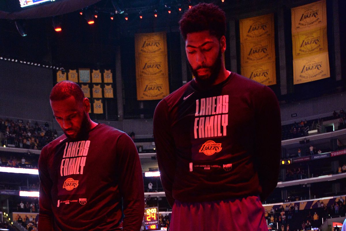 LeBron James #23 of the Los Angeles Lakers and Anthony Davis #3 of the Los Angeles Lakers stand for the National Anthem during Round 1, Game 6 of the 2021 NBA Playoffs on June 3, 2021 at STAPLES Center in Los Angeles, California.