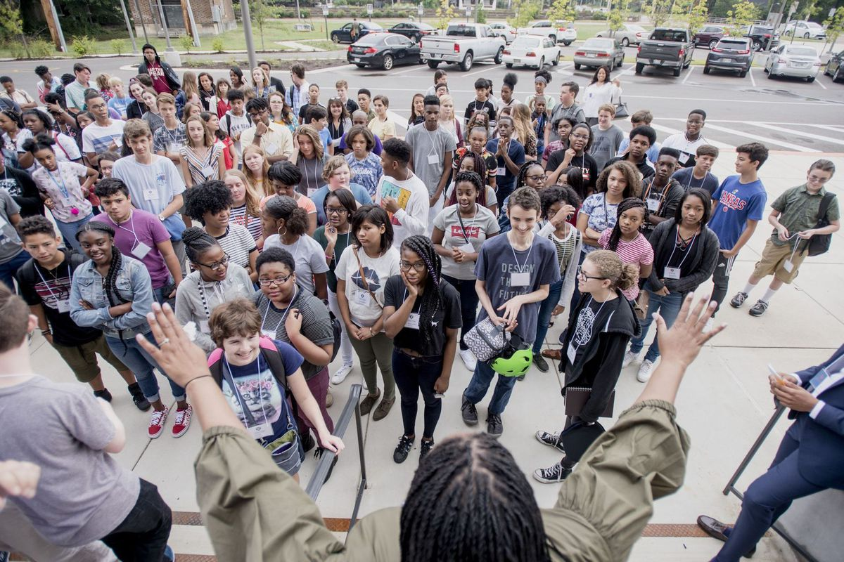 Principal Chandra Sledge-Mathias speaks to Crosstown High School's inaugural ninth grade class outside the building on the first day of school.