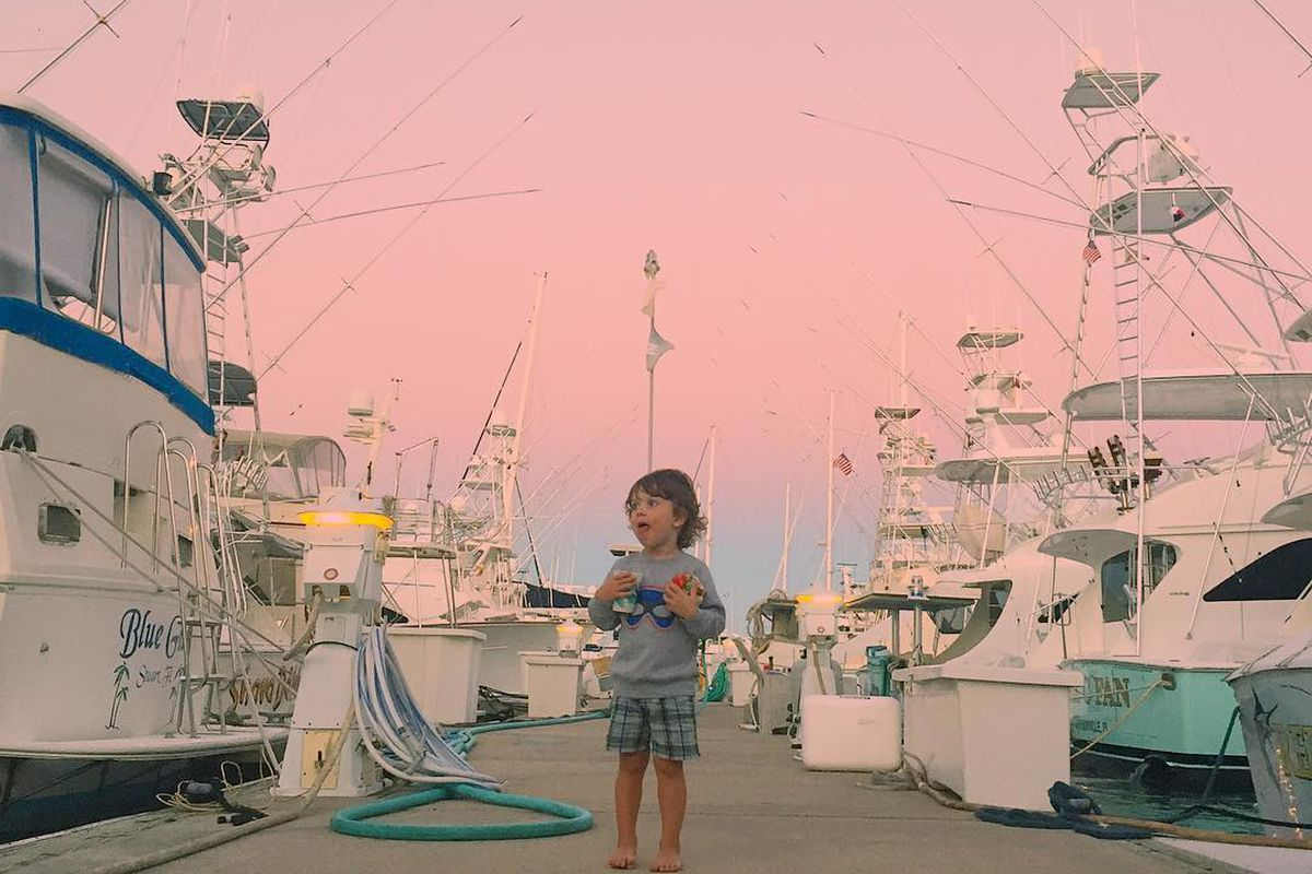boy on boat marina