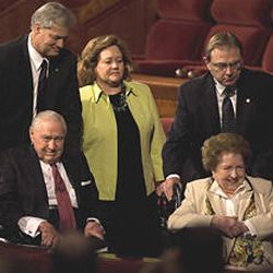 President James E. Faust, left, and his wife, Ruth, leave the LDS Conference Center following the Saturday morning session of the April 2007 General Conference.