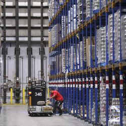 Trinidad Chavez loads up food at the Associated Foods Stores distribution warehouse in Farr West, Weber County, on Tuesday, March 17, 2020.
