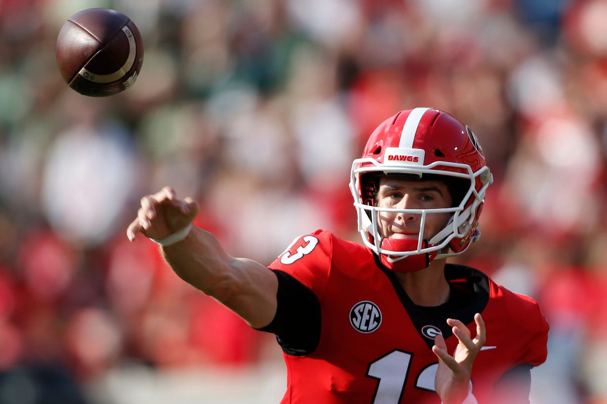 Georgia quarterback Stetson Bennett (13) throws the ball during the first half of an NCAA college football game between UAB and Georgia in Athens, Ga., on Sept 11, 2021.