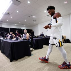 Utah Jazz guard Donovan Mitchell (45) walks in for an interview during the Utah Jazz media media day at Vivint Arena in Salt Lake City on Monday, Sept. 27, 2021.