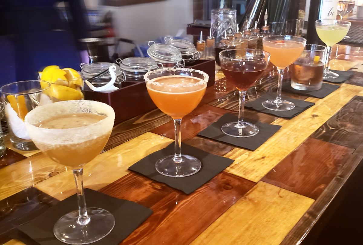 An array of colorful cocktails on the bar at Lady Jaye.