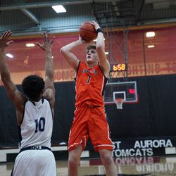 Naperville North's Tom Welch (1) plus a short jump shot against Lincoln Park, Saturday 02-02-19. Worsom Robinson/For the Sun-Times.