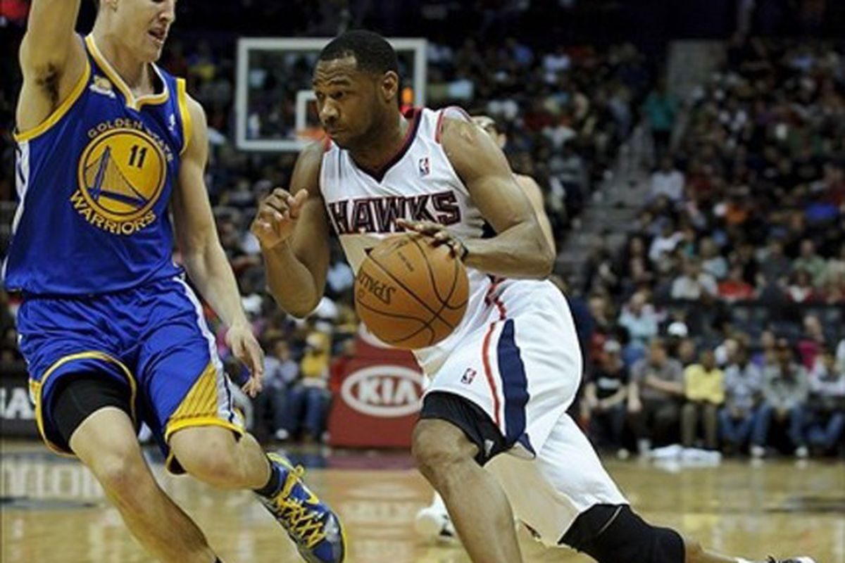 Feb 29, 2012; Atlanta, GA, USA; Atlanta Hawks shooting guard Willie Green (33) drives past Golden State Warriors guard Klay Thompson (11) during the second half at Philips Arena. Golden State won 85-82. Mandatory Credit: Paul Abell-US PRESSWIRE