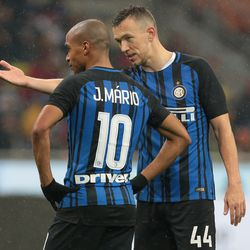 Ivan Perisic of FC Internazionale Milano (R) speaks with his teammate Joao Mario during the TIM Cup match between AC Milan and FC Internazionale at Stadio Giuseppe Meazza on December 27, 2017 in Milan, Italy.