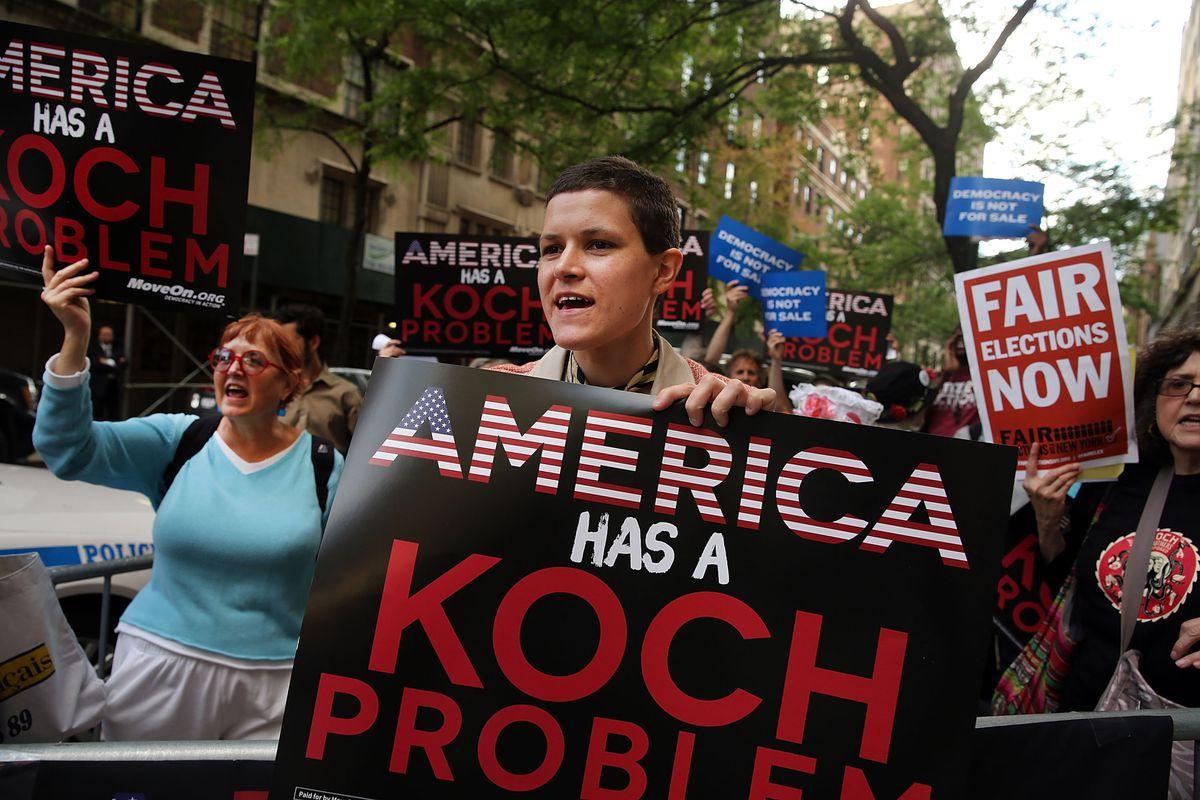 A protest near the Manhattan apartment of billionaire and Republican financier David Koch on June 5, 2014 in New York City.