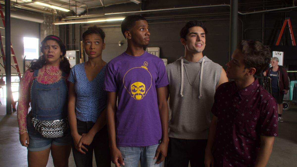 the on my block group stands in a garage