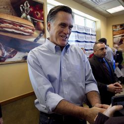 Republican presidential candidate, former Massachusetts Gov. Mitt Romney greets people during a campaign stop at a Cousins Subs fast food restaurant, in Waukesha, Wis., Tuesday, April 3, 2012.