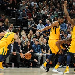Utah Jazz guard Donovan Mitchell (45) and forward Derrick Favors (15) double team Houston Rockets guard Chris Paul (3) causing him to lose the ball that guard Ricky Rubio (3) collects as the Utah Jazz host the Houston Rockets at Vivint Smart Home Arena in Salt Lake City on Thursday, Dec. 7, 2017.